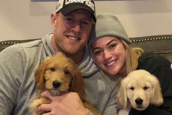 Houston Texans' J.J. Watt and Houston Dash's Kealia Ohai with their puppies Tex and Finley.