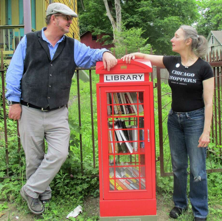 Todd Bol and Annie Bidou with a new Little Free Library in Falls Village. Photo: Jo-Ann Jaacks / Contributed Photo