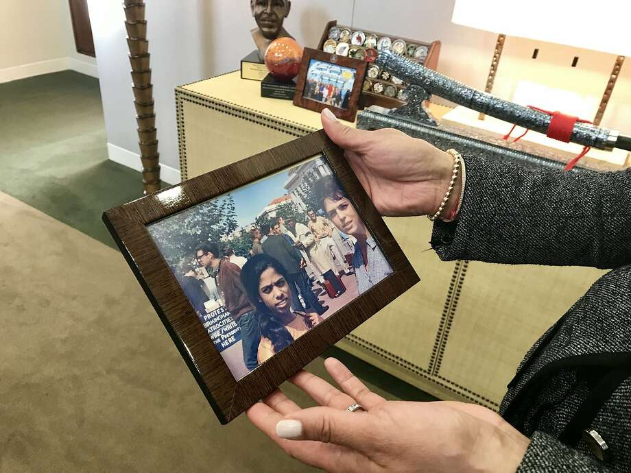 "In her Washington office, Sen. Kamala Harris holds a picture taken at UC Berkeley in the early 1960s of her mother, Shyamala Gopalan, and ""aunt"" Lenore Pomerance, a close friend of Gopalan's. Photo: Tal Kopan / The Chronicle"