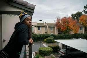 Tyler Roberson, 23, looks out from the balcony at her home in Antioch, Calif., on Sunday, Dec. 16, 2018.