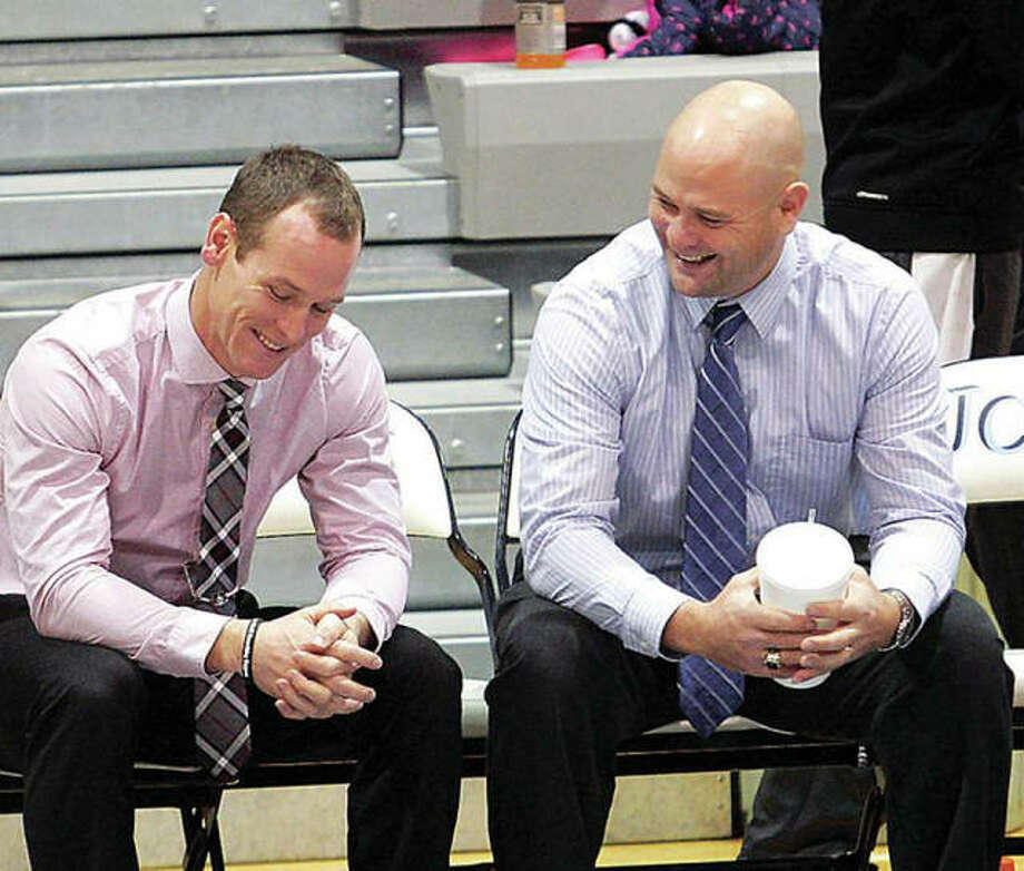 Brother's Chet Reeder, left, and Stote Reeder share a story prior to a 2015 game in Jerseyville between Chet's Sullivan High basketball team and Stote's Jersey Panthers. Chet Reeder is now the head coach at Teutopolis High School.