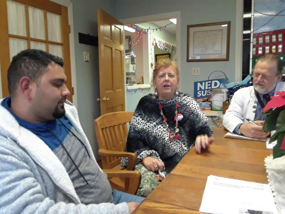 Dr. Matthew Blondin, his wife, attorney Audrey Blondin, and their foster son Orlando Sevilla, a native of Nicaragua, discuss the civil unrest in the country during a recent interview at the couple's office in Torrington.