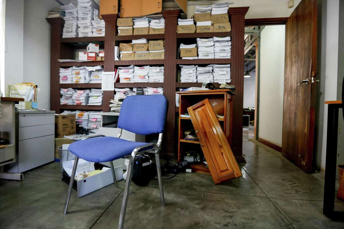 This Dec. 14, 2018 photo shows the ransacked office of the independent media outlet Confidencial, in Managua, Nicaragua. Heavy-handed raids on the country?'s most prominent non-governmental organizations and the seizure of the offices of the independent news outlets Confidencial and 100% Noticias left a clear message that no one _ especially former Sandinista comrades _ was safe from a crackdown on dissent following a wave of protests that increasingly aimed at pushing the 73-year-old president from power. (AP Photo/Alfredo Zuniga)