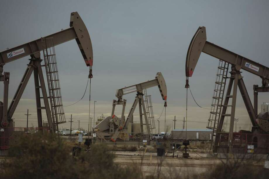 Pump Jacks extract crude oil from oil wells in Midland, Texas. U.S. crude oil production reached an all-time record of 11.3 million barrels per day in August, Energy Information Administration data shows. Texas accounts for an estimated 4.5 million barrels per day of that production. Photo: Angus Mordant / Bloomberg / © 2018 Bloomberg Finance LP