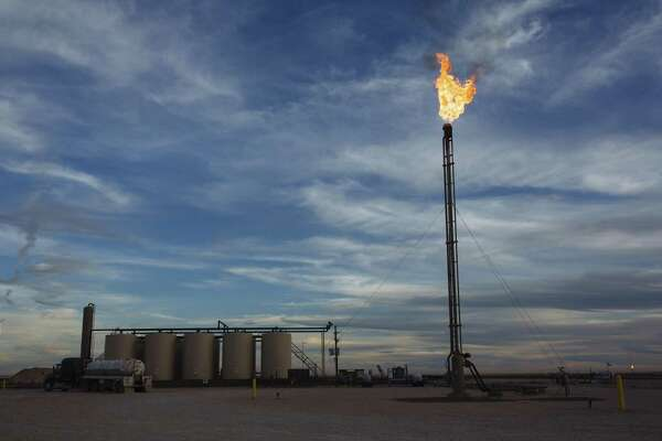 A gas flare burns at a Matador Resources Co. site in the Permian Basin's Loving County. The lack of pipeline capacity created headwinds for some producers who were unable to move the record amounts of crude oil being produced in the Permian Basin of West Texas to market fast enough. With several pipeline projects in the works and some of them expected to be completed in 2019, capacity problems are expected to ease