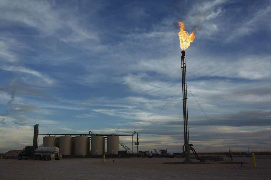 A gas flare burns at a Matador Resources Co. site in the Permian Basin's Loving County. The lack of pipeline capacity created headwinds for some producers who were unable to move the record amounts of crude oil being produced in the Permian Basin of West Texas to market fast enough. With several pipeline projects in the works and some of them expected to be completed in 2019, capacity problems are expected to ease Photo: Angus Mordant / Bloomberg / © 2018 Bloomberg Finance LP