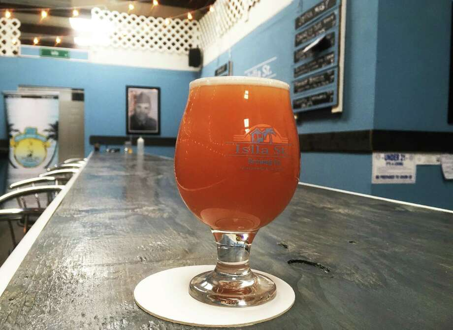 A Pineapple Empanada Double IPA is one of 10 beers on the tap line at Islla St. Brewing Co. The brewery, located near the intersection of O'Connor Road and Wurzbach Pkwy, is opening this weekend. Photo: Chuck Blount /Staff