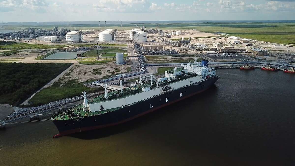 In this July 6, 2018 photo, a carrier ship for liquefied natural gas (s docked at Cheniere's Sabine Pass Terminal in Cameron Parish, La.