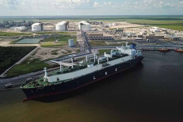In this July 6, 2018 photo, a carrier ship for liquefied natural gas (LNG) is docked at Cheniere's Sabine Pass Terminal in Cameron Parish, La. By specifically promoting LNG exports, the U.S. government is helping guarantee the success of a handful of companies _ using taxpayer dollars to boost a nascent industry it also regulates. Houston-based Cheniere has benefited from the government's LNG push. (Kevin Clancy/Newsy via AP)