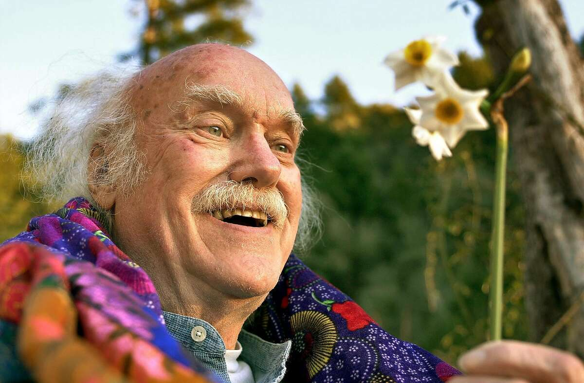 nbdass067db.jpg Ram Dass, 71, studies a narcissus flower outside his home. 1/22/04 in Woodside. DARRYL BUSH / The Chronicle