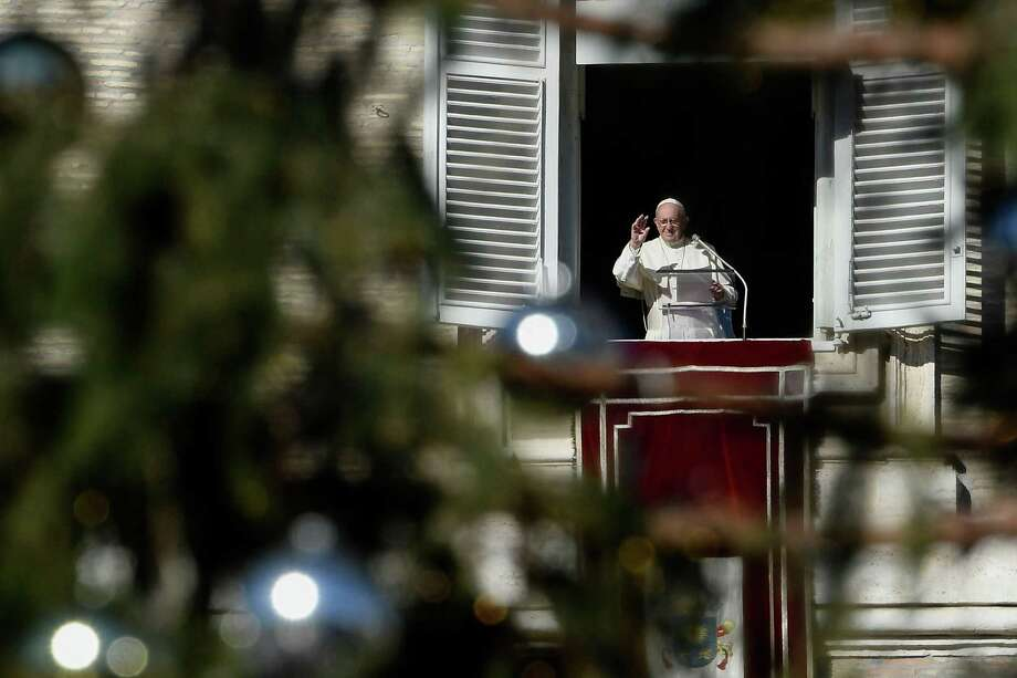 The Vatican has walls. Therefore, walls work in keeping people out, a reader writes. Here, Pope Francis waves as he arrives to deliver his Angelus prayer on Dec. 26 from the window of the Apostolic palace overlooking St Peter's square at the Vatican. Photo: FILIPPO MONTEFORTE /AFP /Getty Images / AFP or licensors