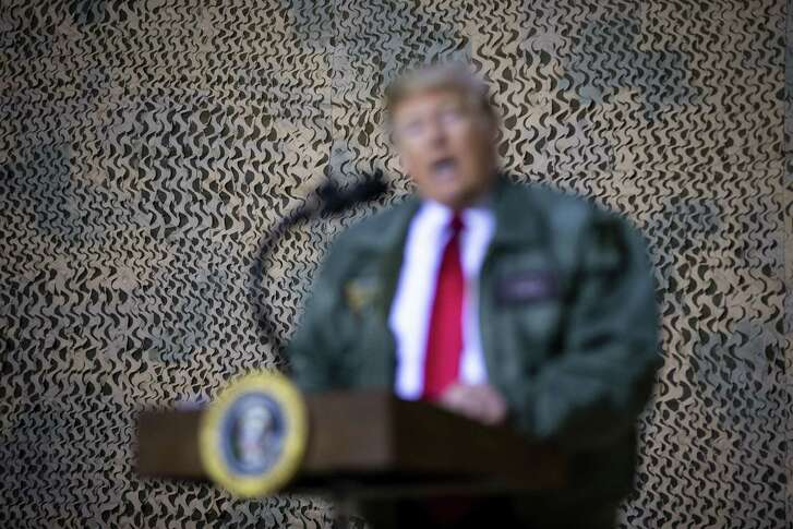 President Donald Trump speaks to members of the military during a visit to Al Asad Air Base in Iraq, Dec. 26, 2018. A review how Trump bent the truth this year by repeating and inflating falsehoods, shifting his statements, embellishing or omitting details, and offering misleading attacks. (Al Drago/The New York Times)