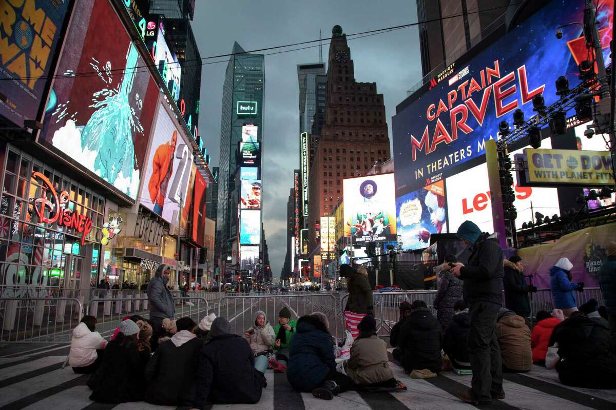 People begin to gather in New York's Times Square in anticipation of the New Year's celebration, Monday, Dec. 31, 2018.