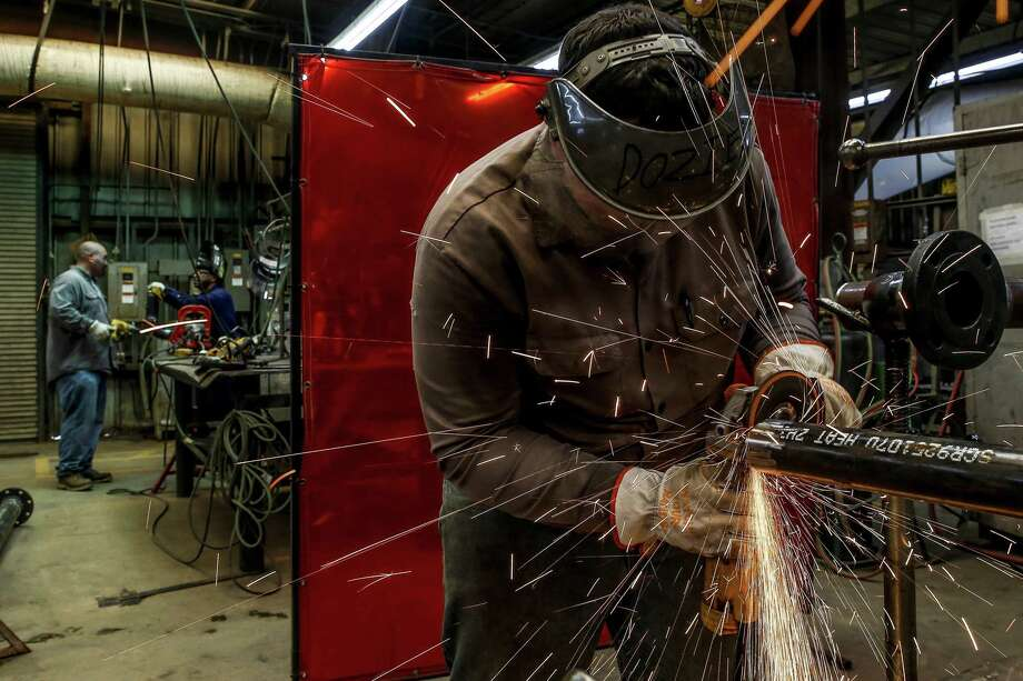 Manufacturing executives' perceptions of broader business conditions improved this month, according to a survey by the Dallas Fed. Photo: Michael Ciaglo, Houston Chronicle / Staff Photographer / Michael Ciaglo