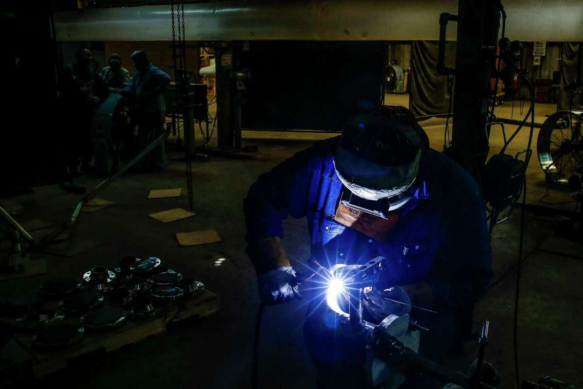 Zachary Construction pipe welder George Culver welds a piece of pipe at the contractor's fabrication site at BASF's petrochemical facility Thursday Aug. 30, 2018 in Freeport.
