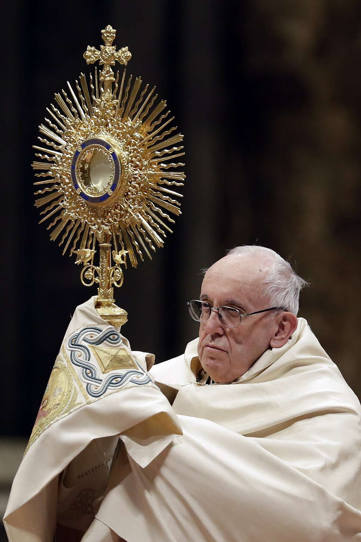 Pope Francis holds a monstrance as he celebrates a new year's eve vespers Mass in St. Peter's Basilica at the Vatican, Monday, Dec. 31, 2018. (AP Photo/Andrew Medichini)
