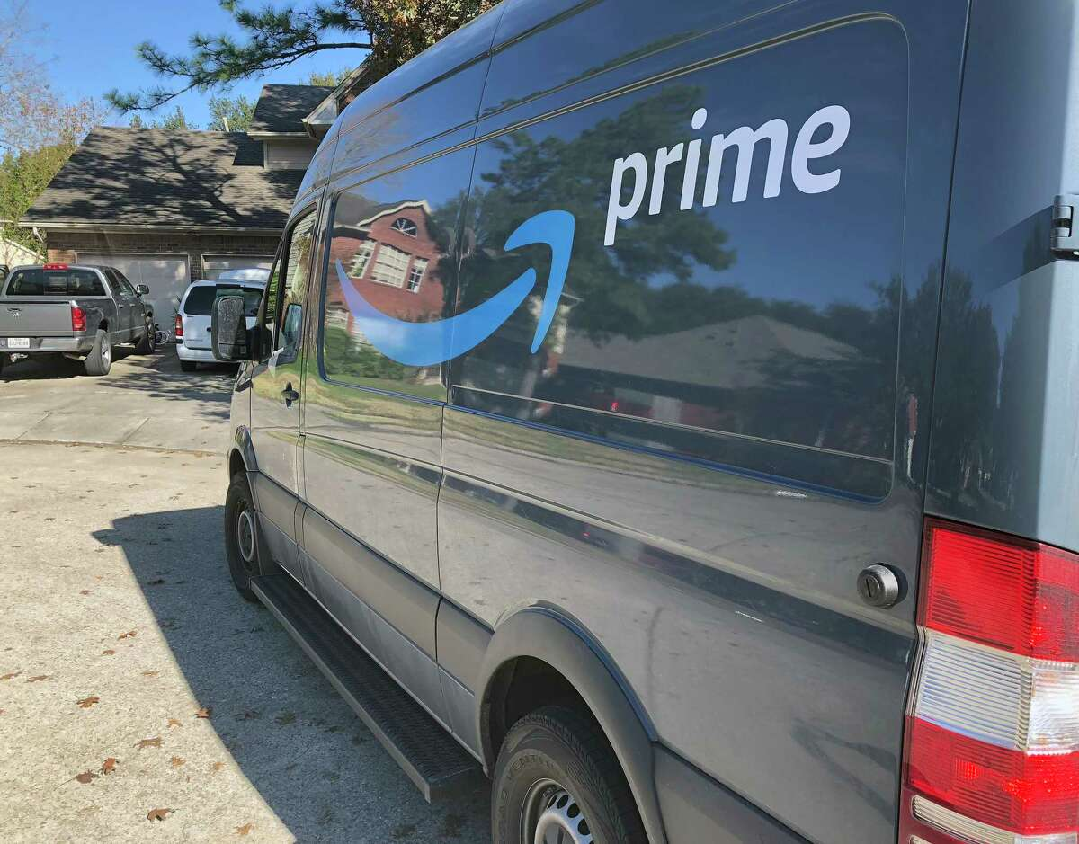 An Amazon delivery van makes a stop in the Clear Lake-area neighborhood of Bay Glen in December 2018.