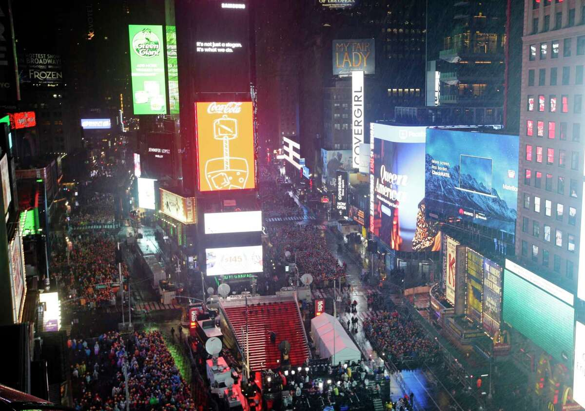Revelers wait for midnight during the New Year's Eve celebration in New York's Times Square, as seen from above from the Marriott Marquis hotel, Monday, Dec. 31, 2018, in New York.