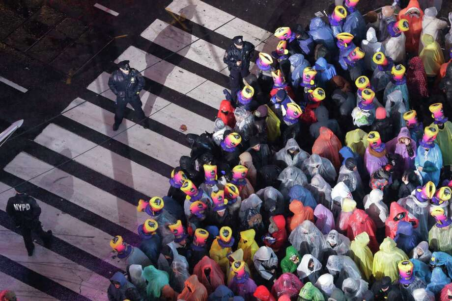 Revelers wait for midnight during the New Year's Eve celebration in New York's Times Square, as seen from above from the Marriott Marquis hotel, Monday, Dec. 31, 2018, in New York. Photo: Frank Franklin II, AP / Copyright 2019 The Associated Press. All rights reserved.