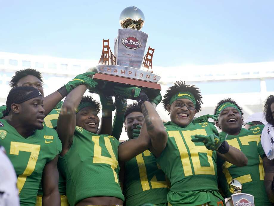 Oregon cornerback Thomas Graham Jr. (4) holds the trophy next to teammates after a 7-6 win over Michigan State during the Redbox Bowl NCAA college football game Monday, Dec. 31, 2018, in Santa Clara, Calif. (AP Photo/Tony Avelar) Photo: Tony Avelar / Associated Press