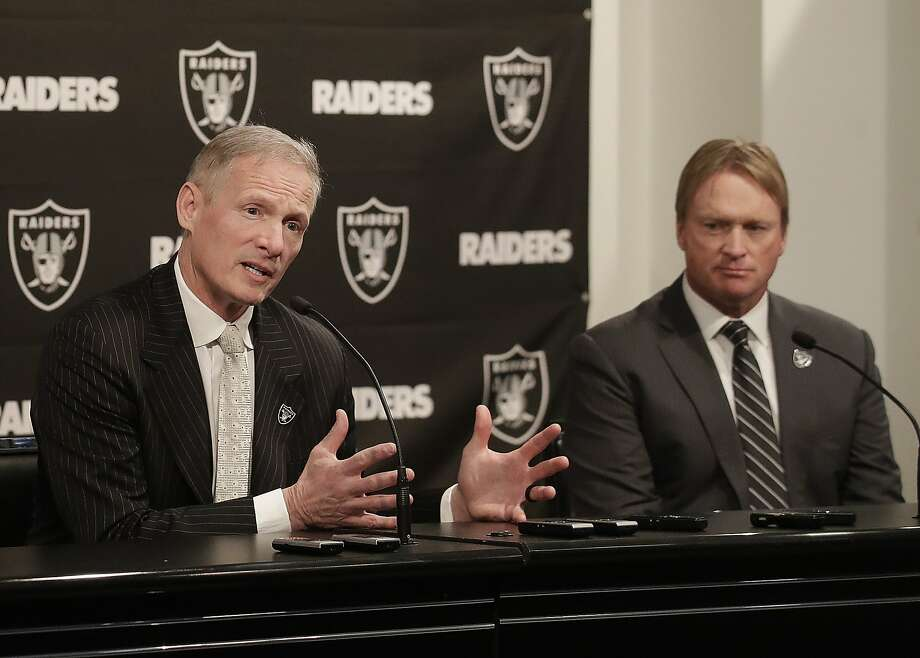Mike Mayock, left, gestures next to Oakland Raiders head coach Jon Gruden at a news conference announcing Mayock as the general manager at the team's headquarters in Oakland, Calif., Monday, Dec. 31, 2018. (AP Photo/Jeff Chiu) Photo: Jeff Chiu, Associated Press