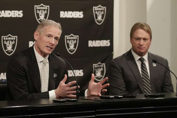 Mike Mayock, left, gestures next to Oakland Raiders head coach Jon Gruden at a news conference announcing Mayock as the general manager at the team's headquarters in Oakland, Calif., Monday, Dec. 31, 2018. (AP Photo/Jeff Chiu)