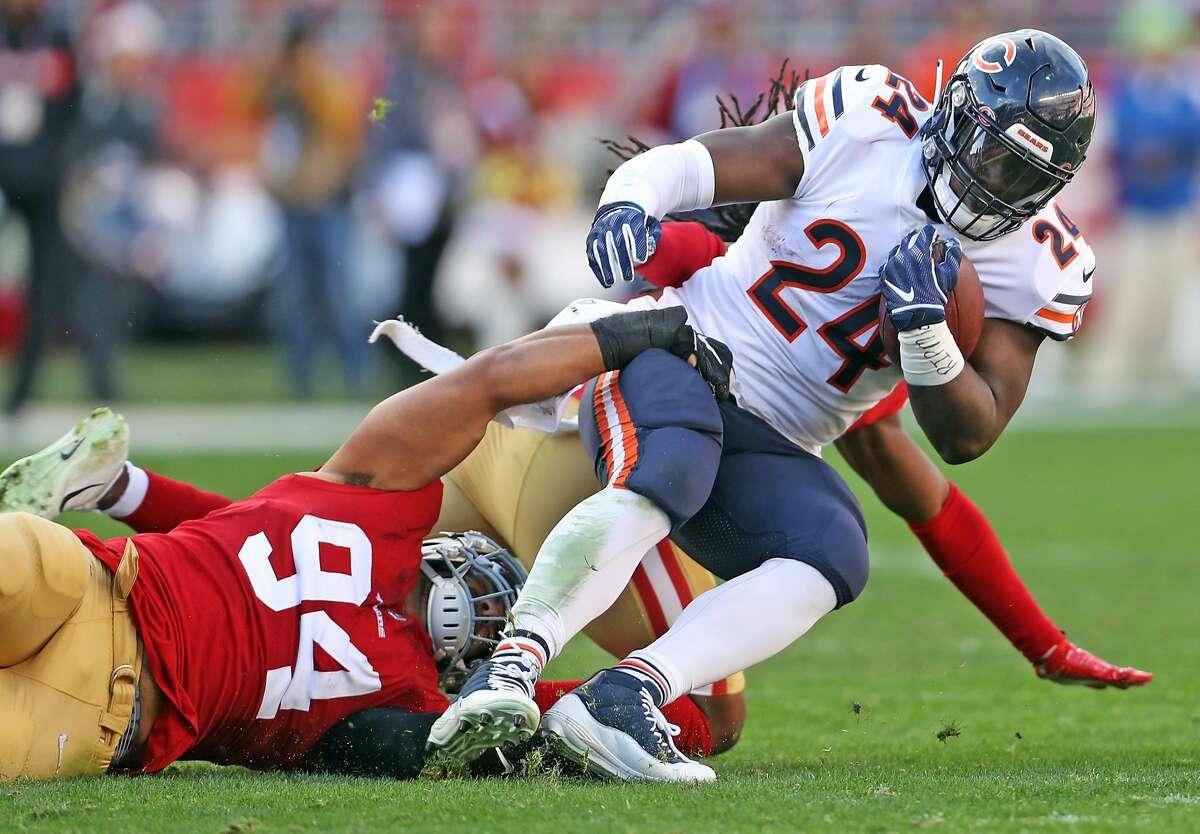 San Francisco 49ers' Solomon Thomas pulls down Chicago Bears' Jordan Howard in 2nd quarter during Bears' 14-9 win in NFL game at Levi's Stadium in Santa Clara, Calif. on Sunday, December 23, 2018.