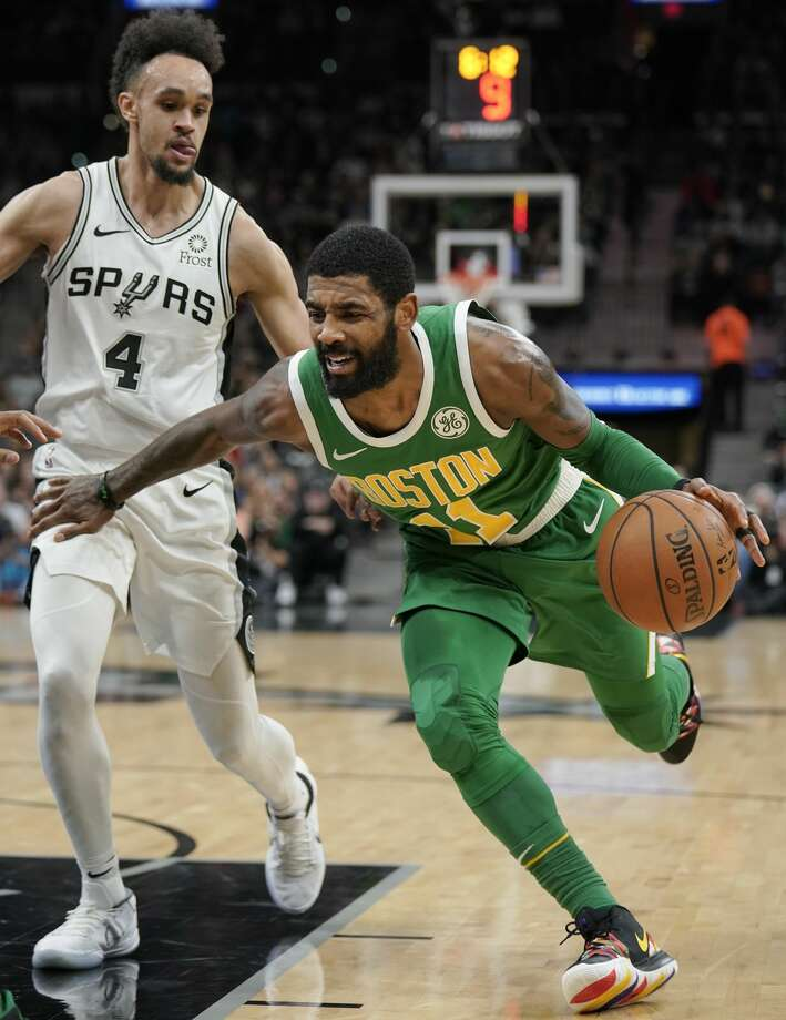 Boston Celtics' Kyrie Irving, right, drives against San Antonio Spurs' Derrick White during the first half of an NBA basketball game, Monday, Dec. 31, 2018, in San Antonio. (AP Photo/Darren Abate) Photo: Darren Abate/Associated Press