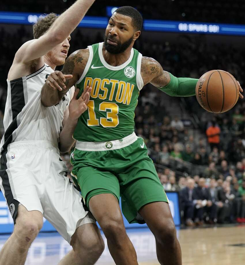 Boston Celtics' Marcus Morris (13) drives against San Antonio Spurs' Jakob Poeltl during the first half of an NBA basketball game, Monday, Dec. 31, 2018, in San Antonio. (AP Photo/Darren Abate) Photo: Darren Abate/Associated Press
