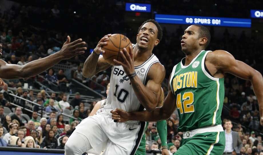 DeMar DeRozan #10 of the San Antonio Spurs drives past Al Horford #42 of the Boston Celtics. Boston Celtics v San Antonio Spurs at AT&T Center on Monday, December 31, 2018. Photo: Ronald Cortes/Contributor