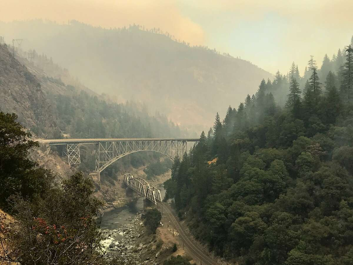 A train and vehicle bridge cross the Feather River in the community of Pulga (Butte County), the suspected origin point of the Camp Fire.