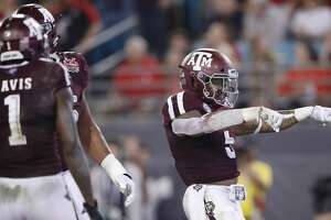 JACKSONVILLE, FL - DECEMBER 31: Trayveon Williams #5 of the Texas A&M Aggies reacts after rushing for a two-yard touchdown against the North Carolina State Wolfpack in the second quarter of the TaxSlayer Gator Bowl at TIAA Bank Field on December 31, 2018 in Jacksonville, Florida. (Photo by Joe Robbins/Getty Images)