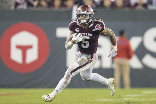 Texas A&M running back Trayveon Williams rushes downfield against North Carolina State during the first half of the Gator Bowl NCAA college football game Monday, Dec. 31, 2018, in Jacksonville, Fla. (James Gilbert/The Florida Times-Union via AP)