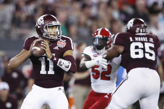 JACKSONVILLE, FL - DECEMBER 31: Kellen Mond #11 of the Texas A&M Aggies looks to pass against the North Carolina State Wolfpack in the first half of the TaxSlayer Gator Bowl at TIAA Bank Field on December 31, 2018 in Jacksonville, Florida. (Photo by Joe Robbins/Getty Images)