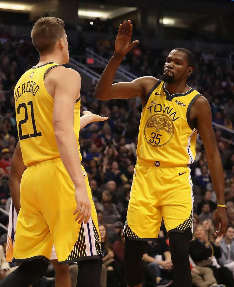 Kevin Durant high-fives Jonas Jerebko after scoring against Phoenix in the first half, when Durant had 15 of his 25 points. Photo: Christian Petersen / Getty Images