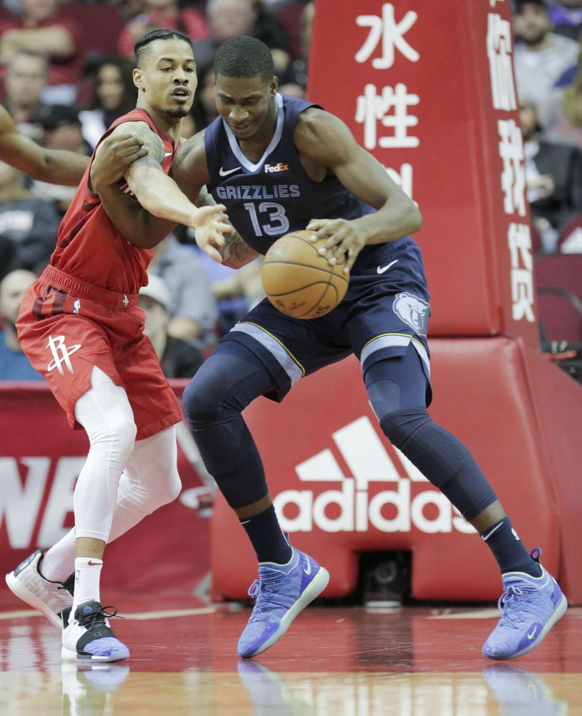 Houston Rockets guard Gerald Green (14) gets caught up with Memphis Grizzlies forward Jaren Jackson Jr. (13) in the first half of NBA game action the Toyota Center on Monday, Dec. 31, 2018 in Houston.