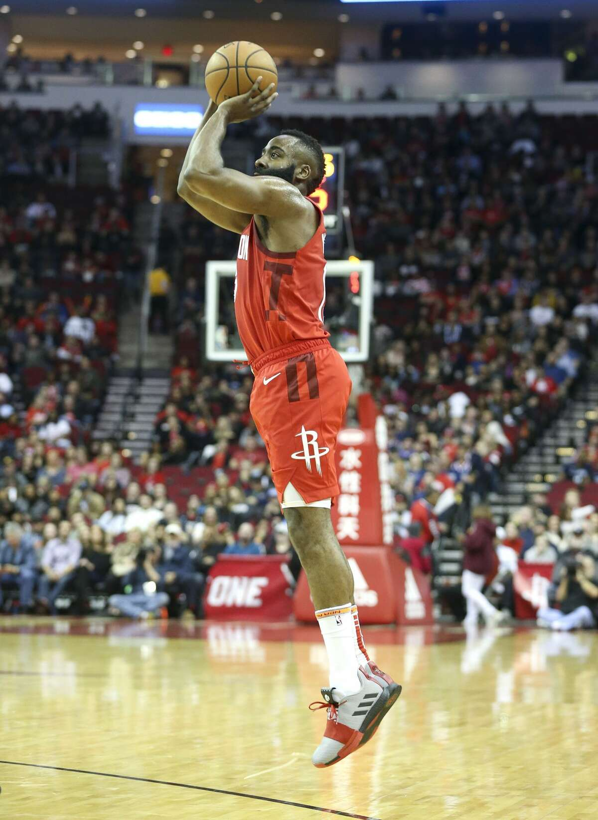 Houston Rockets guard James Harden (13) puts up a three point shot against the Memphis Grizzlies at the Toyota Center on Monday, Dec. 31, 2018 in Houston. Harden scored 43 points and got a a triple in the team's 113-101 win.