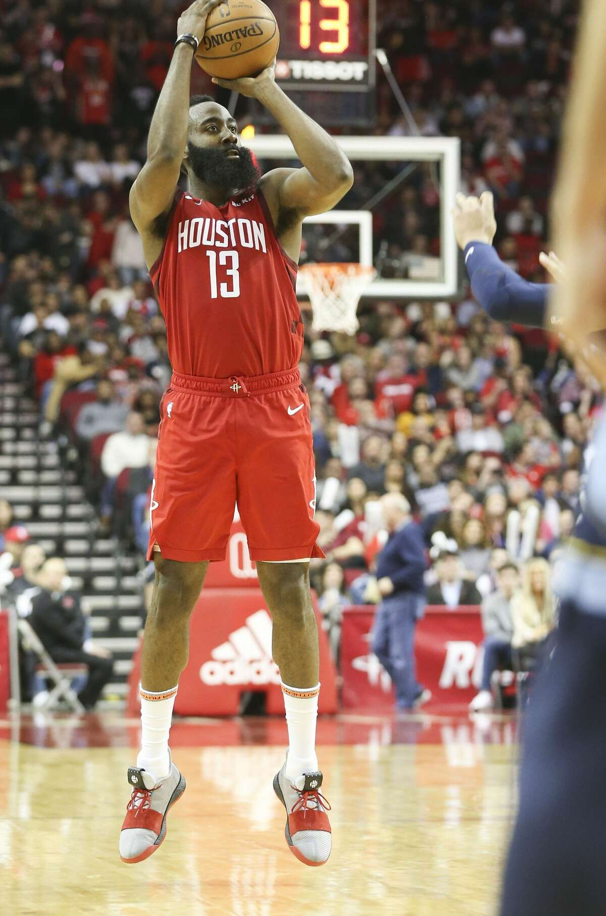 With 13 seconds left on the shot clock, Houston Rockets guard James Harden (13) puts up a three point shot against the Memphis Grizzlies at the Toyota Center on Monday, Dec. 31, 2018 in Houston. Harden scored 43 points and got a a triple in the team's 113-101 win. Houston Rockets host the Memphis Grizzlies at the Toyota Center on Monday, Dec. 31, 2018 in Houston. Rockets won the game 113-101.