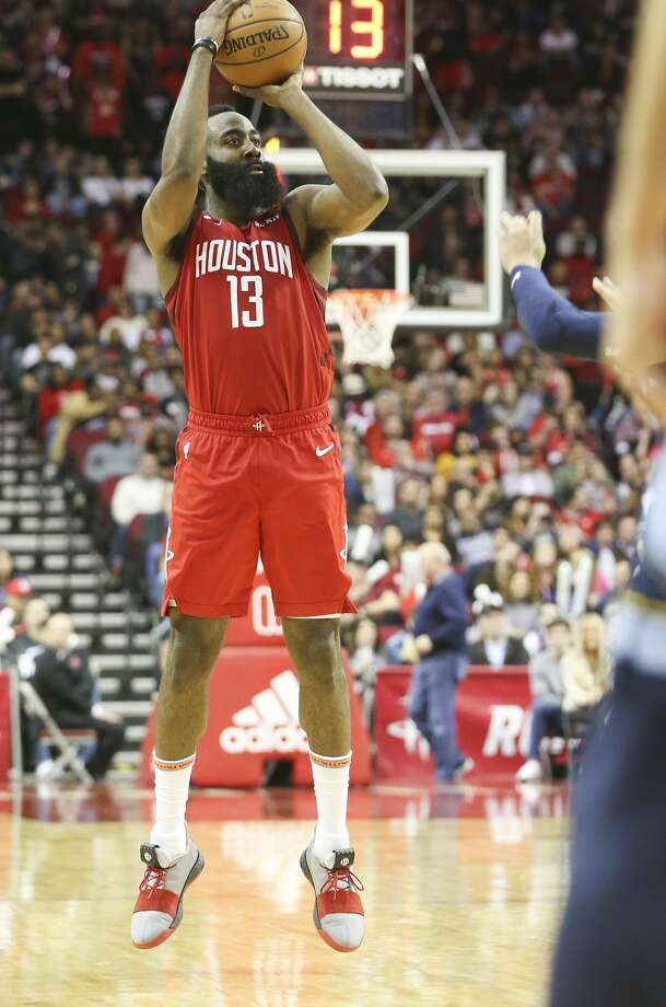 With 13 seconds left on the shot clock, Houston Rockets guard James Harden (13) puts up a three point shot against the Memphis Grizzlies at the Toyota Center on Monday, Dec. 31, 2018 in Houston. Harden scored 43 points and got a a triple in the team's 113-101 win. Houston Rockets host the Memphis Grizzlies at the Toyota Center on Monday, Dec. 31, 2018 in Houston. Rockets won the game 113-101. Photo: Elizabeth Conley/Staff Photographer