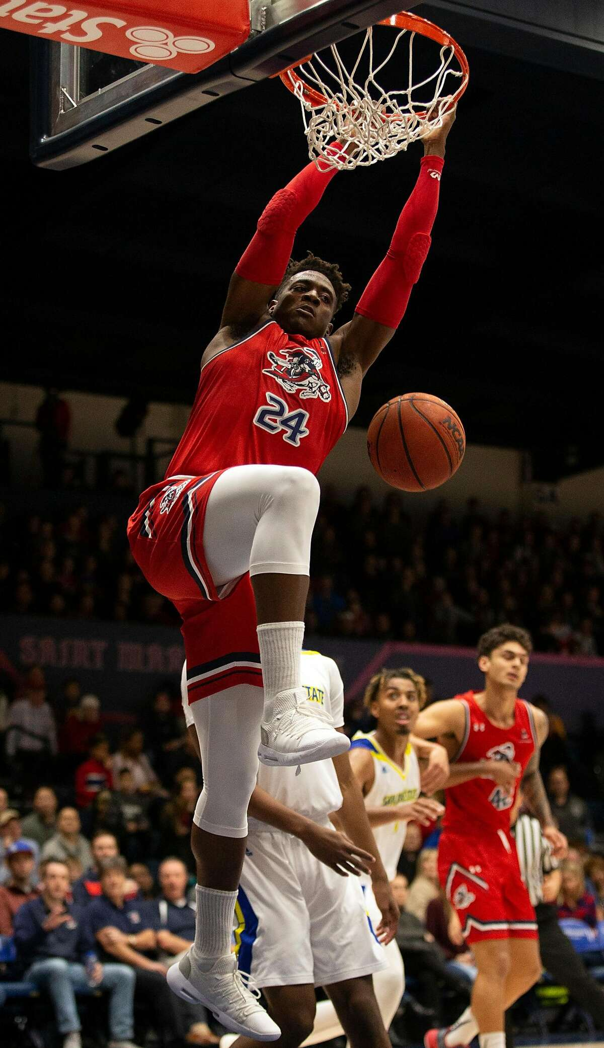 Saint Mary's Malik Fitts (24) dunks over San Jose State's Seneca Knight (23) during the first half of an NCAA men's basketball game, Saturday, Dec. 29, 2018 in Moraga, Calif.