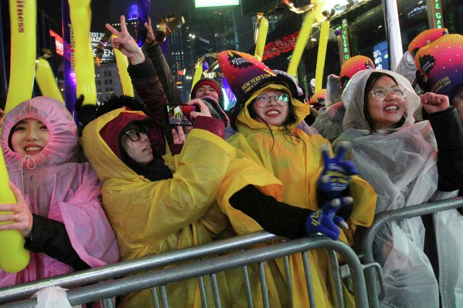 Ting Ouyang, from Philadelphia, Pa., right, and others take part in the New Year's Eve festivities in New York's Times Square, Monday, Dec. 31, 2018. Photo: Tina Fineberg, AP / FR73987 AP