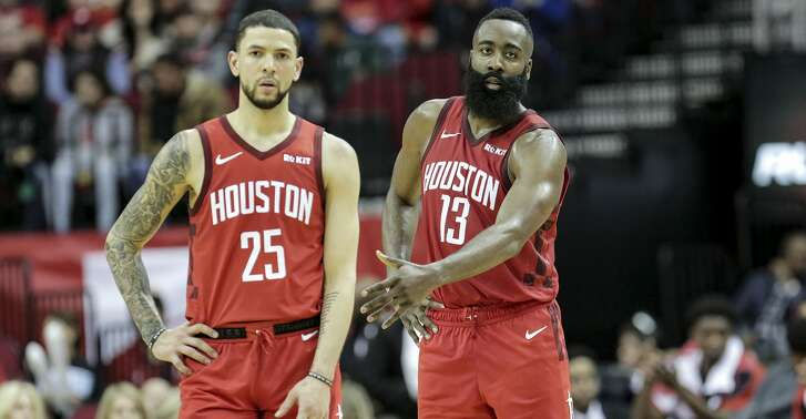 Houston Rockets guard James Harden (13) pulls back Houston Rockets guard Austin Rivers (25) in the fourth quarter against the Memphis Grizzlies at the Toyota Center on Monday, Dec. 31, 2018 in Houston. Rockets won the game 113-101.