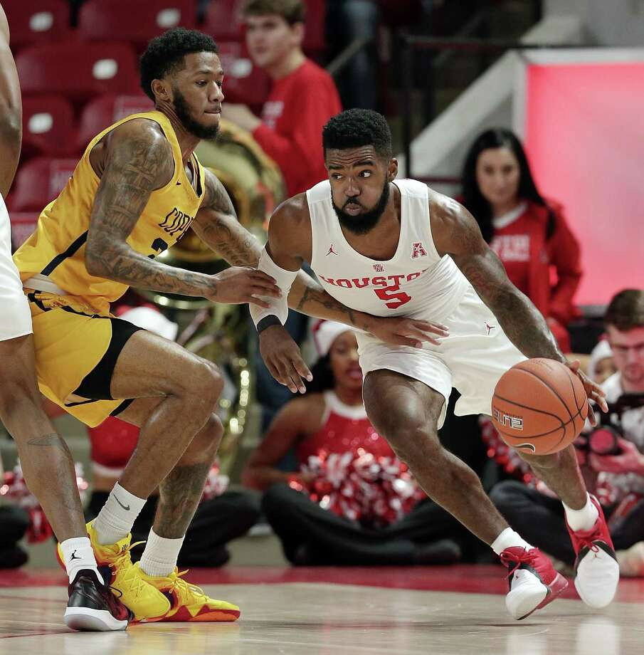 Houston guard Corey Davis Jr. (5) drives around Coppin State guard Taqwain Drummond (2) during the first half of an NCAA college basketball game Sunday, Dec. 23, 2018, in Houston. (AP Photo/Michael Wyke) Photo: Michael Wyke, FRE / Associated Press / Copyright 2018 The Associated Press. All rights reserved.