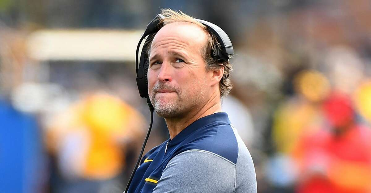 MORGANTOWN, WV - SEPTEMBER 09: Head coach Dana Holgorsen of the West Virginia Mountaineers looks on during the third quarter against the East Carolina Pirates at Mountaineer Field on September 9, 2017 in Morgantown, West Virginia. West Virginia won the game 56-20. (Photo by Joe Sargent/Getty Images)