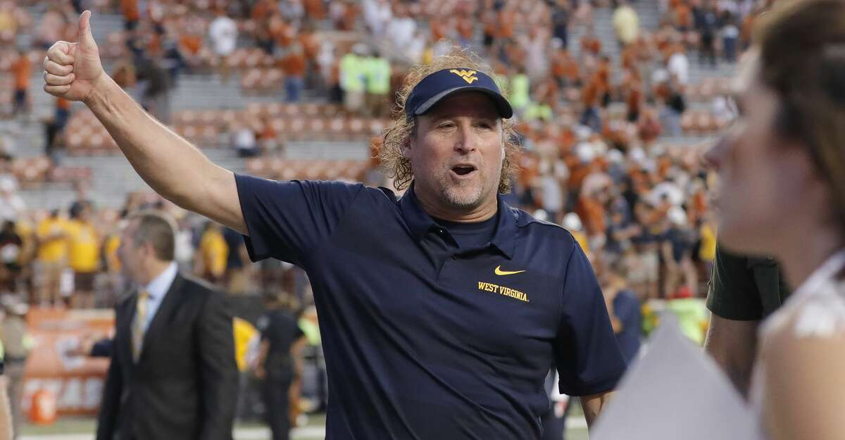AUSTIN, TX - NOVEMBER 03: Head coach Dana Holgorsen of the West Virginia Mountaineers celebrates after the game against the Texas Longhorns at Darrell K Royal-Texas Memorial Stadium on November 3, 2018 in Austin, Texas. (Photo by Tim Warner/Getty Images)