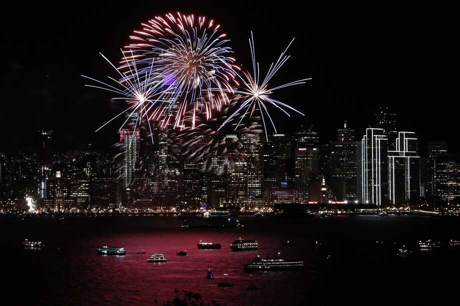 Fireworks light up the night sky over the Embarcadero as the west coast rang in the New Year in San Francisco, Calif., on Tuesday, January 01, 2019. Photo: Carlos Avila Gonzalez, The Chronicle