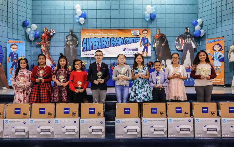 "Ten LISD students were recently named winners of the Watermill Express Annual ""Healthy Habits"" Writing Contest during a ceremony at D.D. Hachar Elementary School, where they received a laptop and printer as a reward. Photo: LISD /Courtesy Photo"