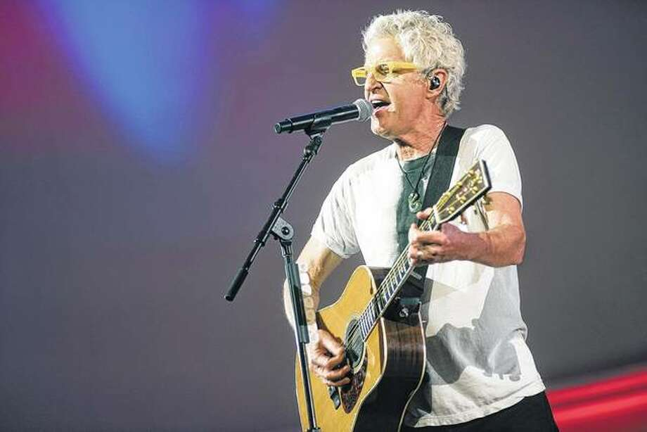 Kevin Cronin, lead singer of REO Speedwagon, performs Dec. 3 at the Illinois bicentennial party at Navy Pier in Chicago. The state celebrated the 200th anniversary of its becoming the nation's 21st state. Photo: Paul Natkin | Getty Images