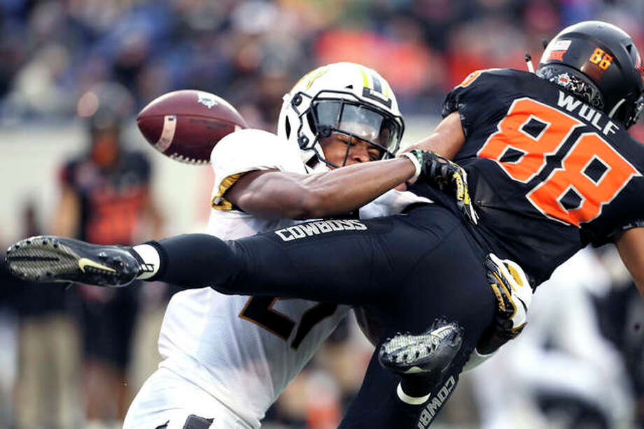 Missouri defensive back Christian Holmes breaks up a pass intended for Oklahoma State wide receiver Landon Wolf during the first half of Monday night's Liberty Bowl in Memphis. Photo: AP Photo
