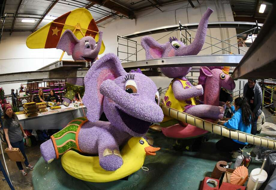 Volunteers work on the Northwestern Mutual float to be included in the annual Tournament of Roses Parade in Pasadena, that will take place before the Rose Bowl collegiate football game between Ohio State University and the University of Washington on New Years Day, in Los Angeles, California on December 29, 2018. - This year's 105th Rose Parade, will be seen by hundreds of thousands of spectators on the parade route and broadcast to millions of fans in over 100 countries. The tradition dates back to 1890. (Photo by Mark RALSTON / AFP)        (Photo credit should read MARK RALSTON/AFP/Getty Images) Photo: MARK RALSTON/AFP/Getty Images